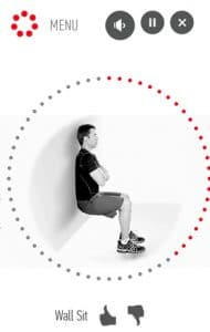 The 7 Minute Workout interface is shown with a man doing a wall sit exercise