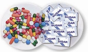 The Power of Expectations: Pills are shown side-by-side with sugar packets. Showing the power of expectations.