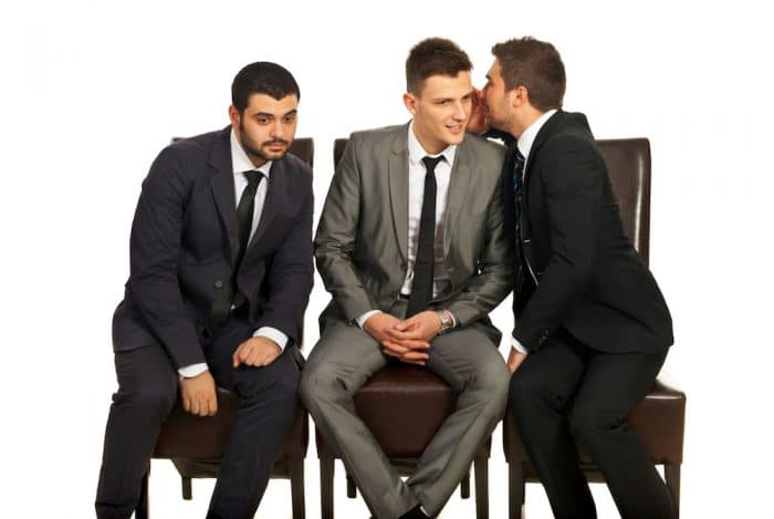 It is important for you to evaluate your associations on a regular basis. Three men are pictured and two of the men are gossiping while purposefully leaving the other out of the conversation.