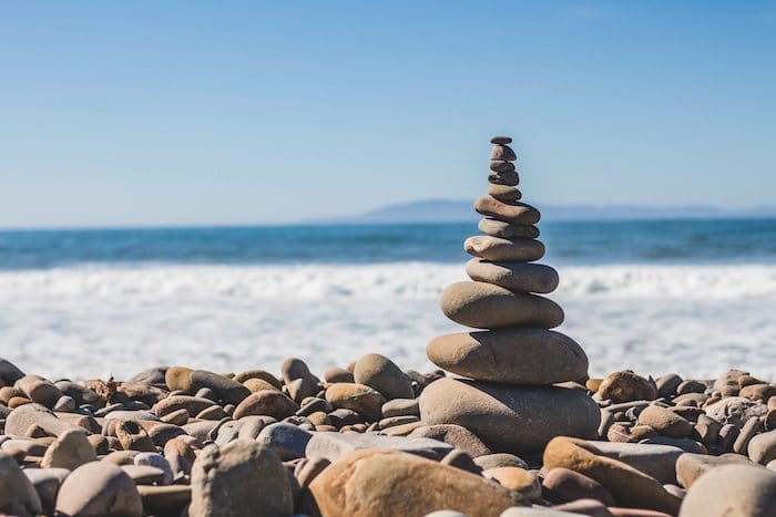 12 Rocks balance on top of each others. Finding life balance can be challenging but is necessary for ultimate fulfillment.