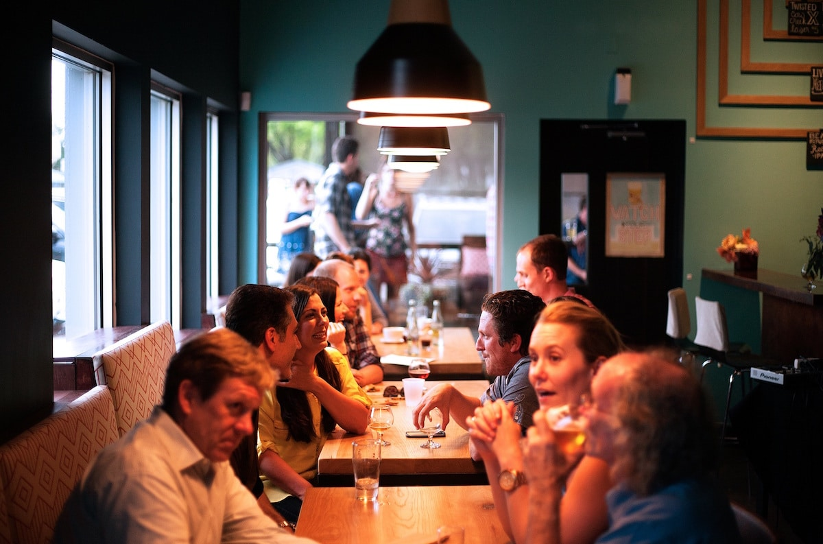 Crowded restaurant table - A Crowded Bar Is Shown With People Talking At Dinner You Can Enhance Your Life