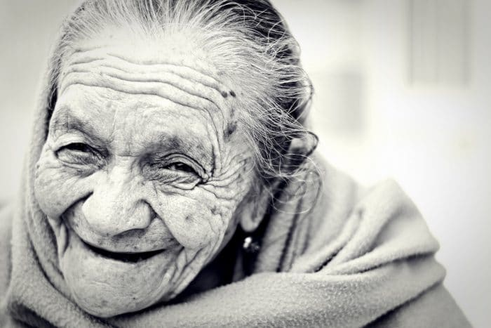 An old woman smiles: She shows that it is important for us to use the reality of death to our advantage.
