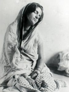 Anandamayi Mi is picture in a deeply meditative state.