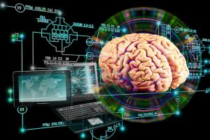 A computer generated image shows a human brain next to a computer and tablet with scientific and computer generated symbols around them. This image represents the idea that your brain is a computer.