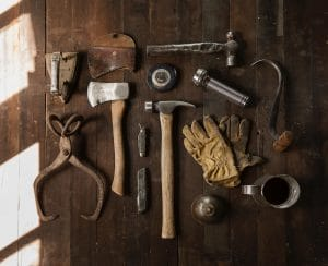 A set of tools is shown nicely laid out on a table. This image represents the idea that there are a wide variety of CBT tools that therapists use to improve the mental health of their patients.