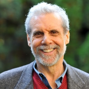 A headshot is shown of decorated psychologist and author Daniel Goleman.