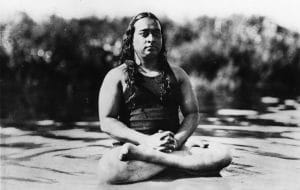 An image shows Paramahansa Yogananda sitting in a traditional meditation posture.