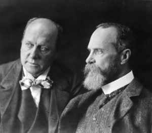 An image shows the immortalized James Brothers. While Henry James was being celebrated as an author, William James became the Father of American Psychology.
