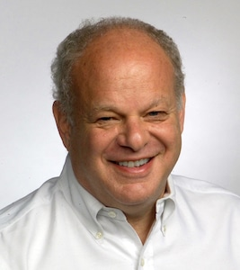 A headshot image is shown for the famed psychologist Martin Seligman.